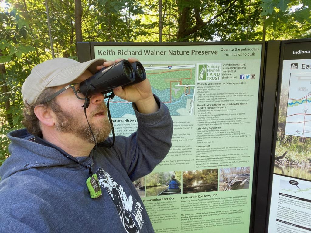 photo of Brad Bumgardner withbinoculars at Walner Nature Presreve in Chesterton