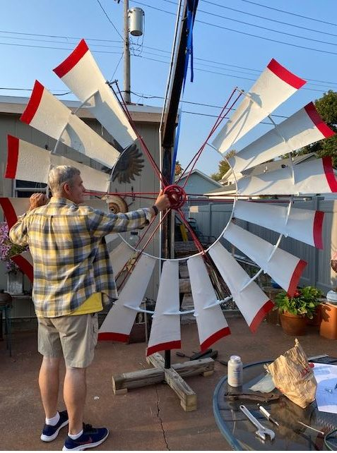 Volunteer Rob Perkins and the windmill fan he is restoring