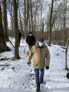 Hikers on a snowy trail at Lydick Bog Nature Preserve