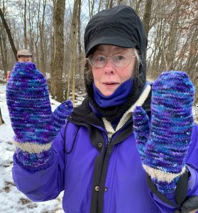 Woman holding up her mittens